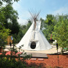 UPSCALE CAMPING IN TIPI AND CAMPER