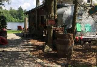 Vintage camper near waterfall