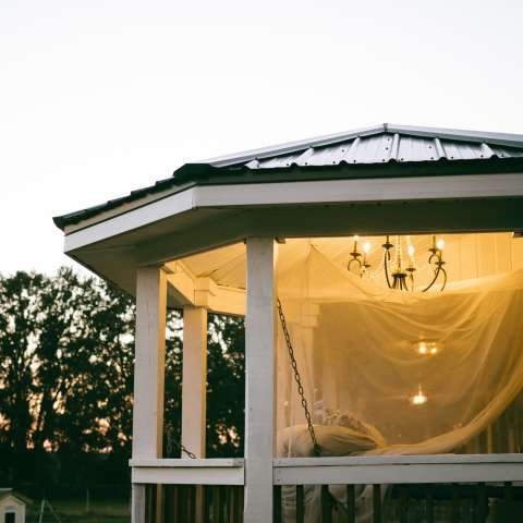 Netted hanging bed under stars