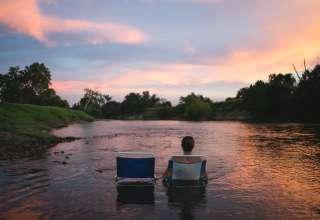 people sunset swimming