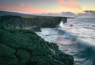 This shot was taken at 5:30am at Holei Sea Arch. In Hawaii Volcanoes National Park. This location is about an hour drive from the main gate.