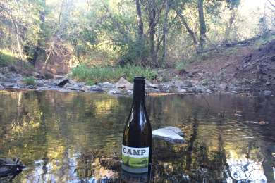 Campsites are nestled up to a little creek. Refreshing for your toes or your wine.