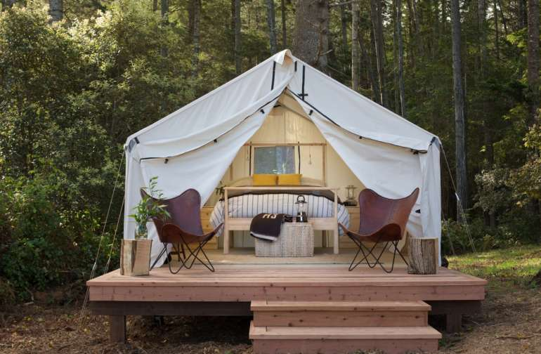 our tents come fully furnished with Queen Bed, Cotton Linens and down comforter.  Each site has private porch, fire ring and complimentary bundle of wood daily