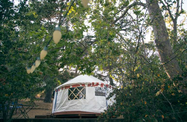 The yurt sits on top of the concrete ruins of a house (a duplex home to two Navy civilian families for more than 45 years, Myrna tells us.)