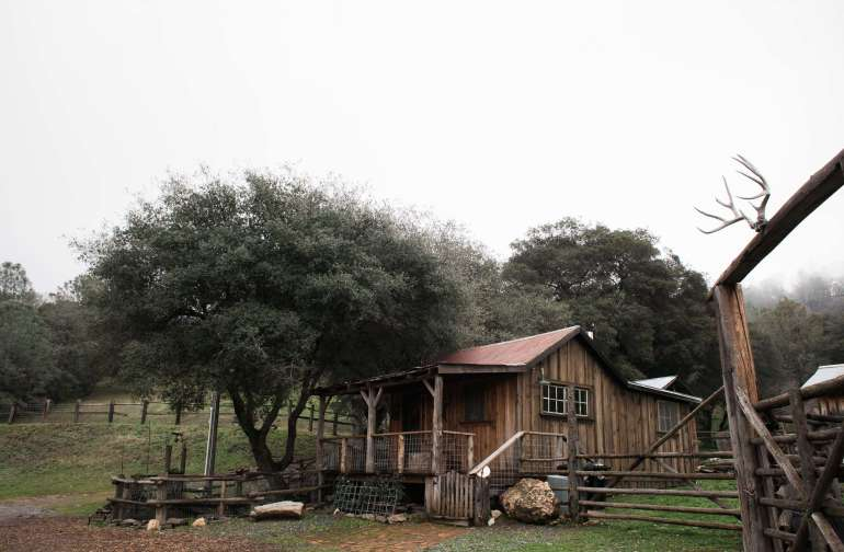 View of the cabin and corral from the barn