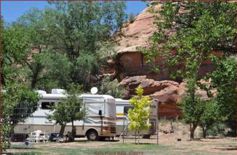RV with red rock cliffs at your door step.