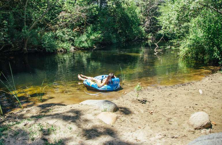 Private cove with floaties and camping chairs to enjoy the river