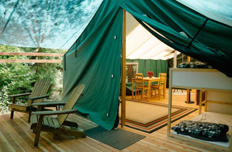 Afternoon light makes this glamping tent feel homey and welcoming. Photo by Nic Castellanos.
