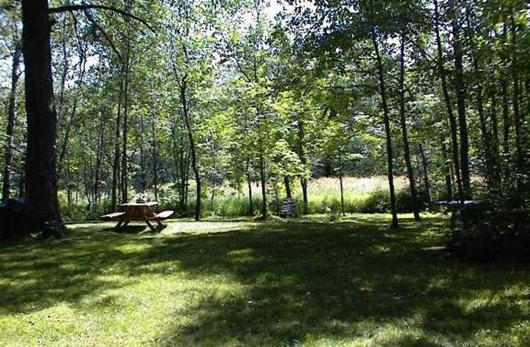 Sit at the picnic table and enjoy the view.