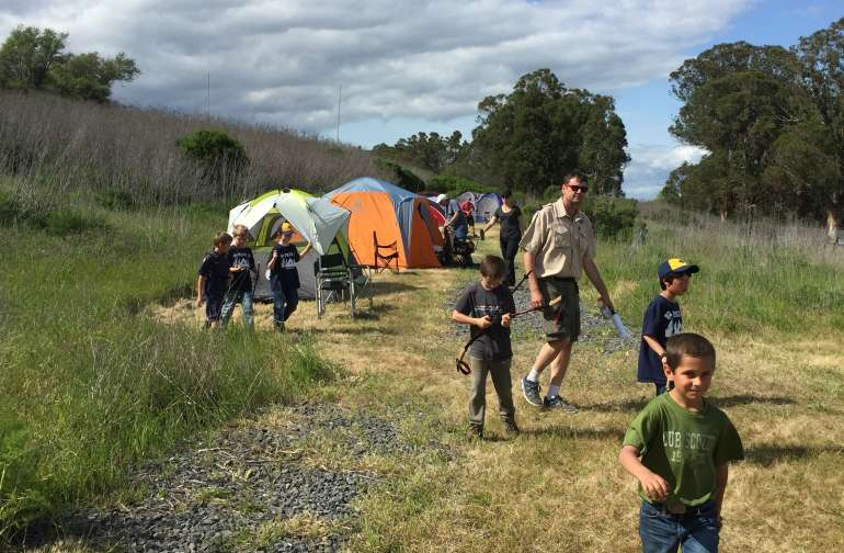 our camp spots are simple mowed areas along an old railroad track minus the tracks, but close to the visitor center, campfire, cooking and portable restrooms.