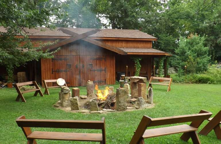 The main longhall building and communal fire pit.