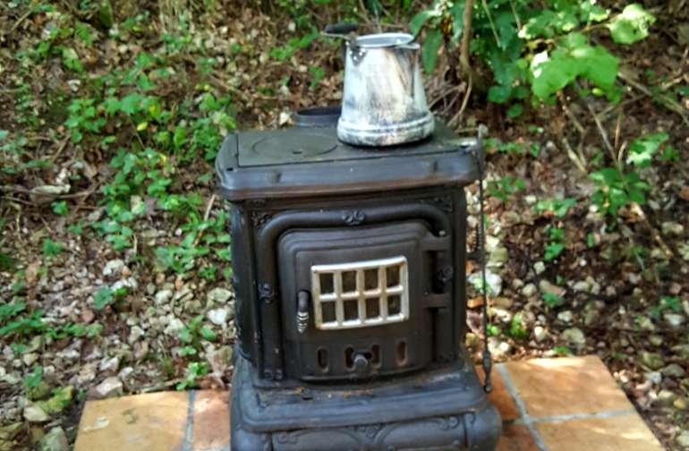 Outdoor cooking on wood burning stove.
