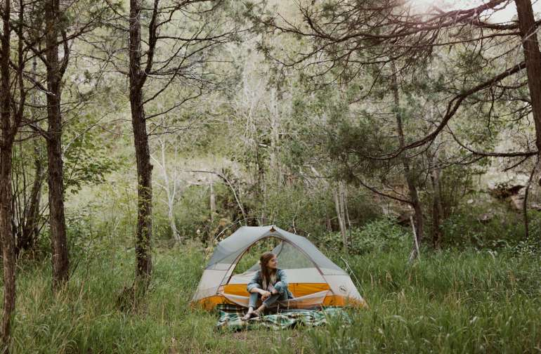 Tent camping by the stream.