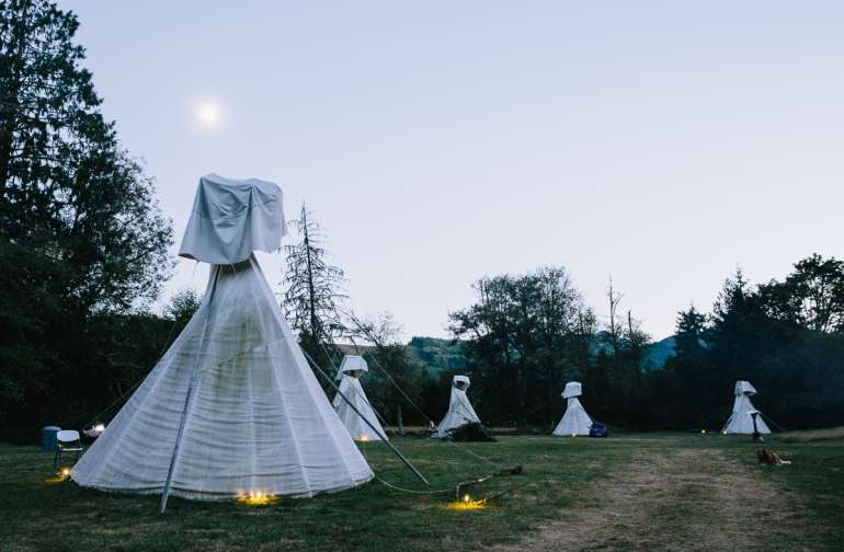 The meadow of tipis and solar lights.