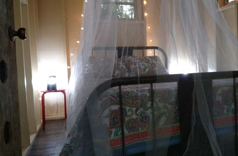 Fine bedding with mosquito netting encloses you in a cocoon of luxury as the sound of nature lulls you to sleep.