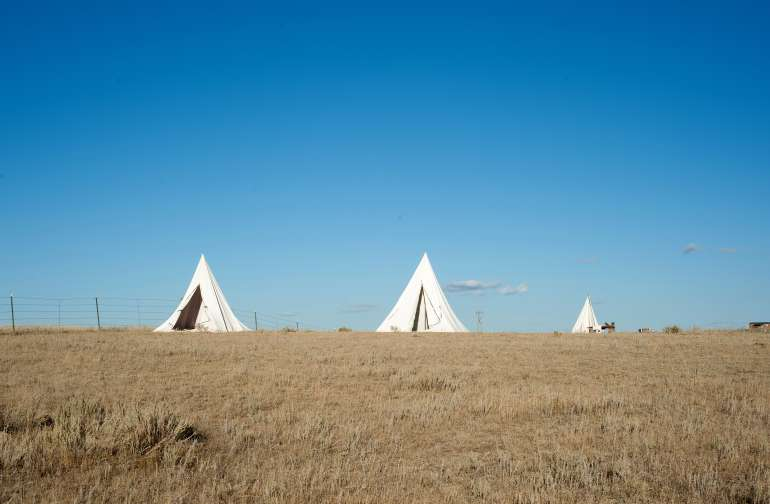 Tepees and outhouse