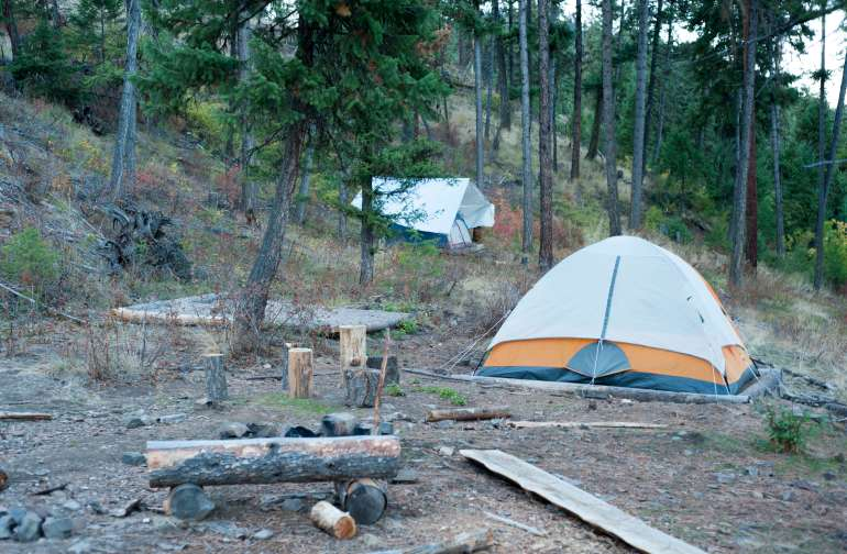 Chances are there will be other people camping with you — make the most of it and enjoy the communal fire pit.