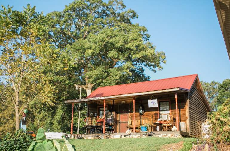 The Cabin as you drive up. It sits on a hill overlooking the pasture and the pond.
