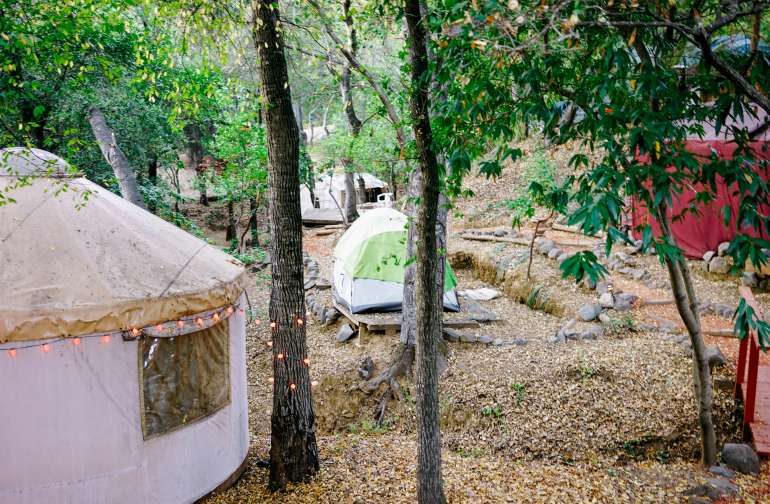 Next to the yurts are wooden platforms you can set your tent up.