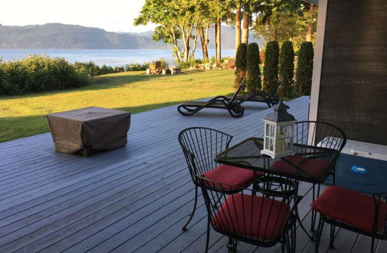 Enjoy the large deck, patio furniture, gas fire pit and the incredible ocean views!