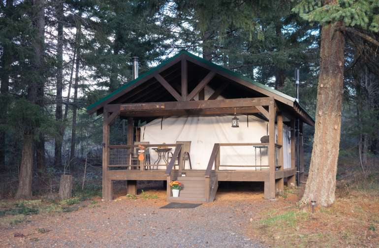 Call it a tent if you want, but this is luxury. Full kitchen, bed, shower, and wood stove inside.
