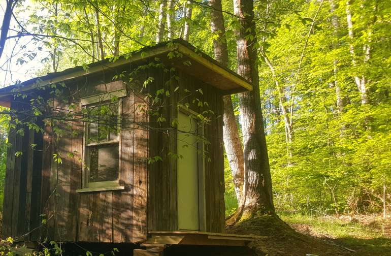 Tucked in the edge of the woods you will find our Whistle Pig Camping Cabin