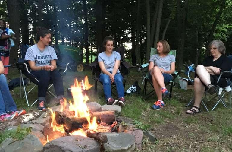 Sitting around the campfire .