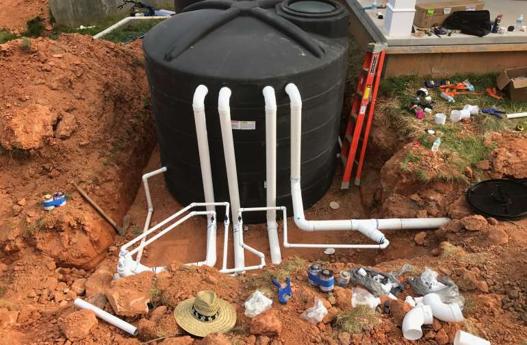 Rainwater catchment system that is plumbed internally to the house for drinking water, dishes, laundry, and greywater system. The house also can run off of a well pump.