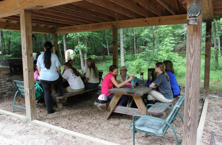 Summer camp riders enjoying a picnic at the shelter
