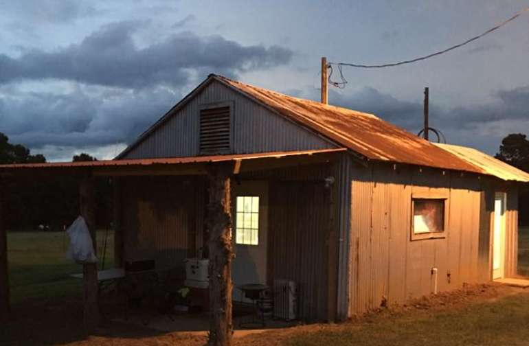 "Rustic 1950""s cabin."