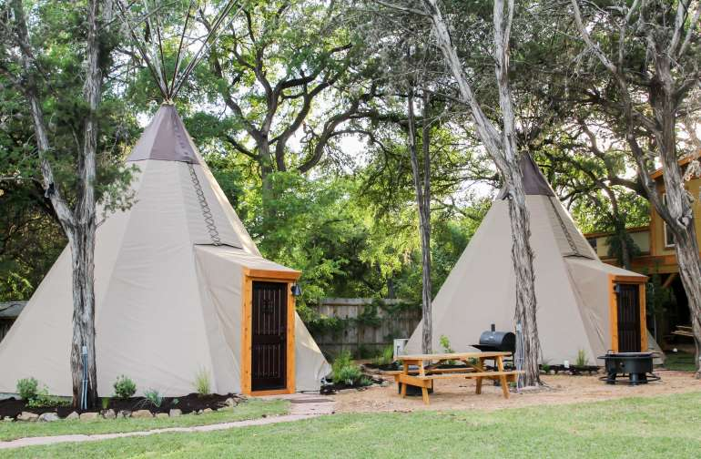 We have 8 custom tipis at our site.