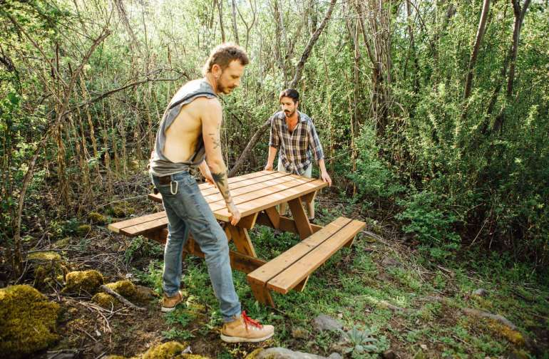 The Hosts, Steven and Derrick moving their freshly made picnic table up to The Quarry campsite.