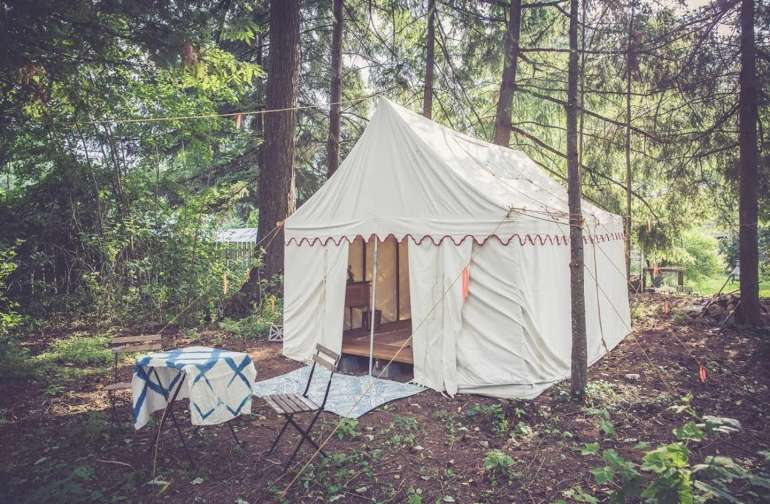 Canvas wall tent in the backyard woods