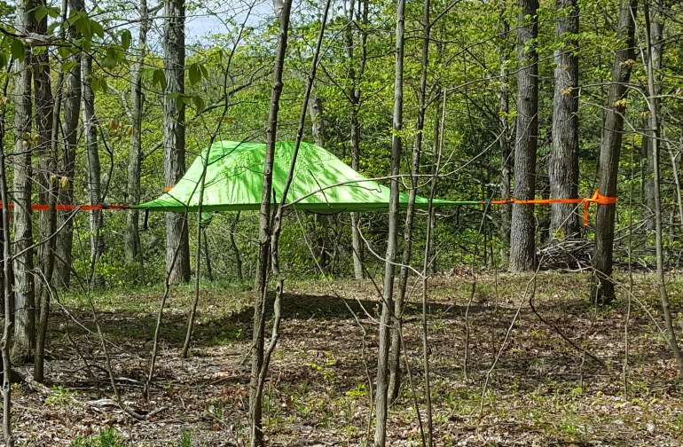 Tent's about 4ft from the ground. You can access it from the front opening or as I prefer through the center.
