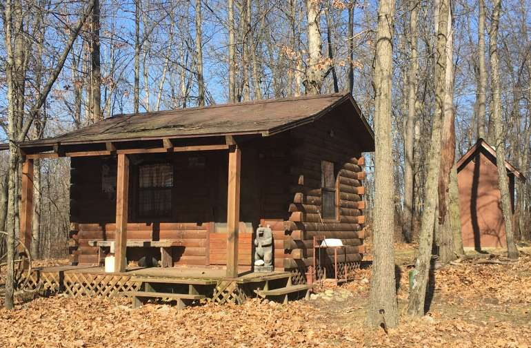 An outside view of our little cabin on the river> And you can see the outhouse (potty) too.