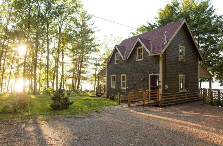 Late-evening sun illuminates the back of the cabin.