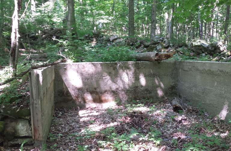 Cement foundation provided a flat area for a tent