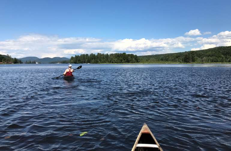 Paddling on Brant Lake from our dock and put-in.