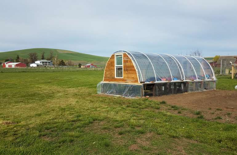 Greenhouse and camp sits.
