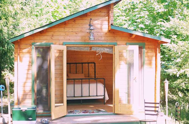 The quaint cabin that rests in 20 acres of beautiful lush property