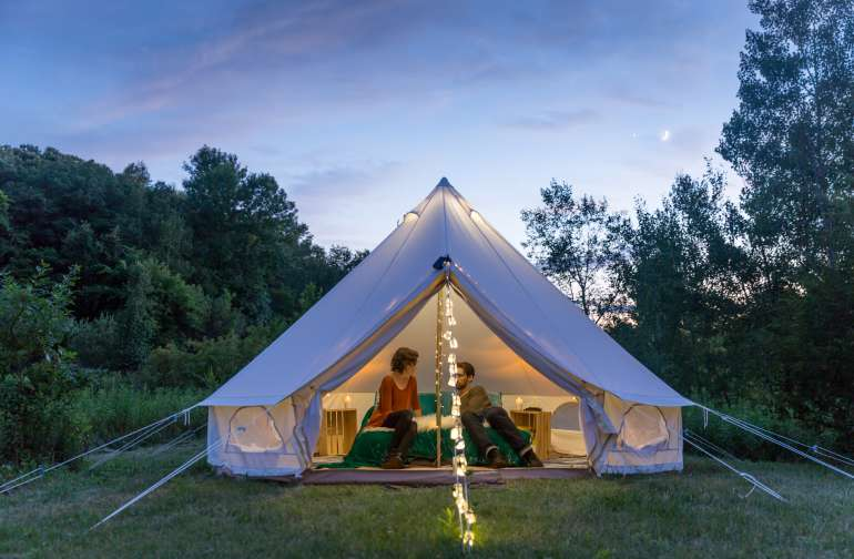 There is nothing more magical than a tent at twilight.  The bell tent is set up with pretty string lights on the posts and down the front, as well as a lantern hanging from inside the top, so even after dark the tent was an inviting place to hang out.