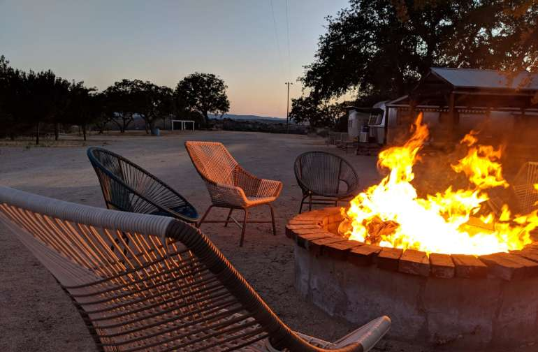 Large fire pit with comfy chairs.  Not pictured there is an outdoor covered kitchen, BBQ grill, and dinner table for 50+