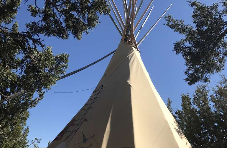 tipi with blue skies