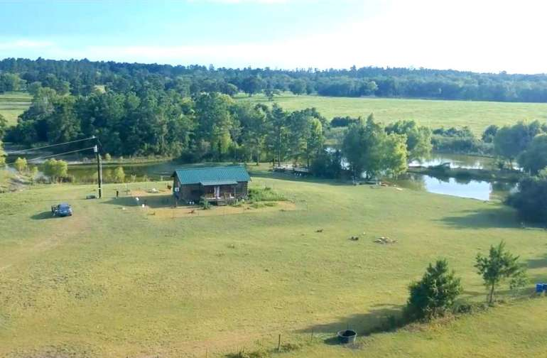 Aerial view of the log cabin and surroundings.