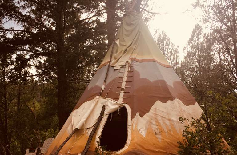 "Hand painted 18' ""Prairie Fire"" tipi on deck."