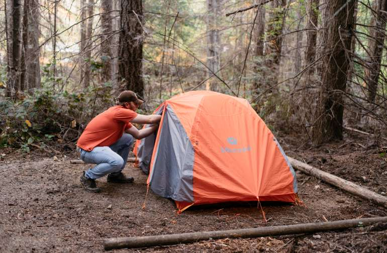 Size comparison. They have several sites to set up your tent in. This is a 2 person backpacking tent. Guy in red shirt is over 6' 3''.  Plenty of space all around.