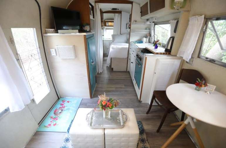 1960 Overlander front living area, kitchen, private bedroom and back end bath with roomy shower