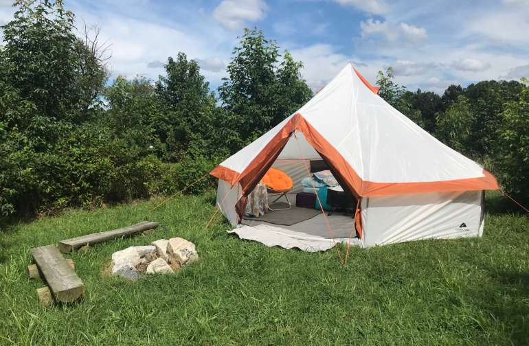 A glamping tent camp site. Scroll through our photos to see interiors.