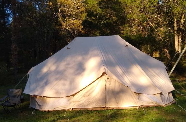 Safari bell tent in the woods.