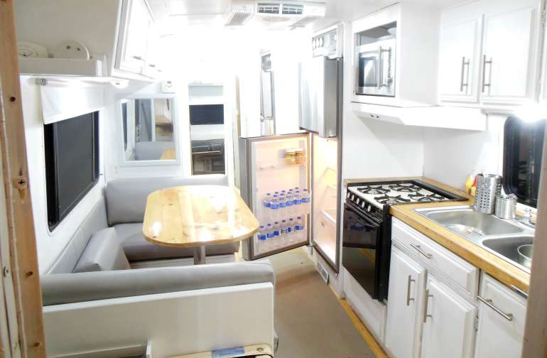 Inside your Director's Trailer, looking from the front bedroom/office into the kitchen.